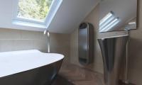 Z240 - Аккуратный дом простой традиционной формы с гаражом и дополнительной спальней на первом этаже.